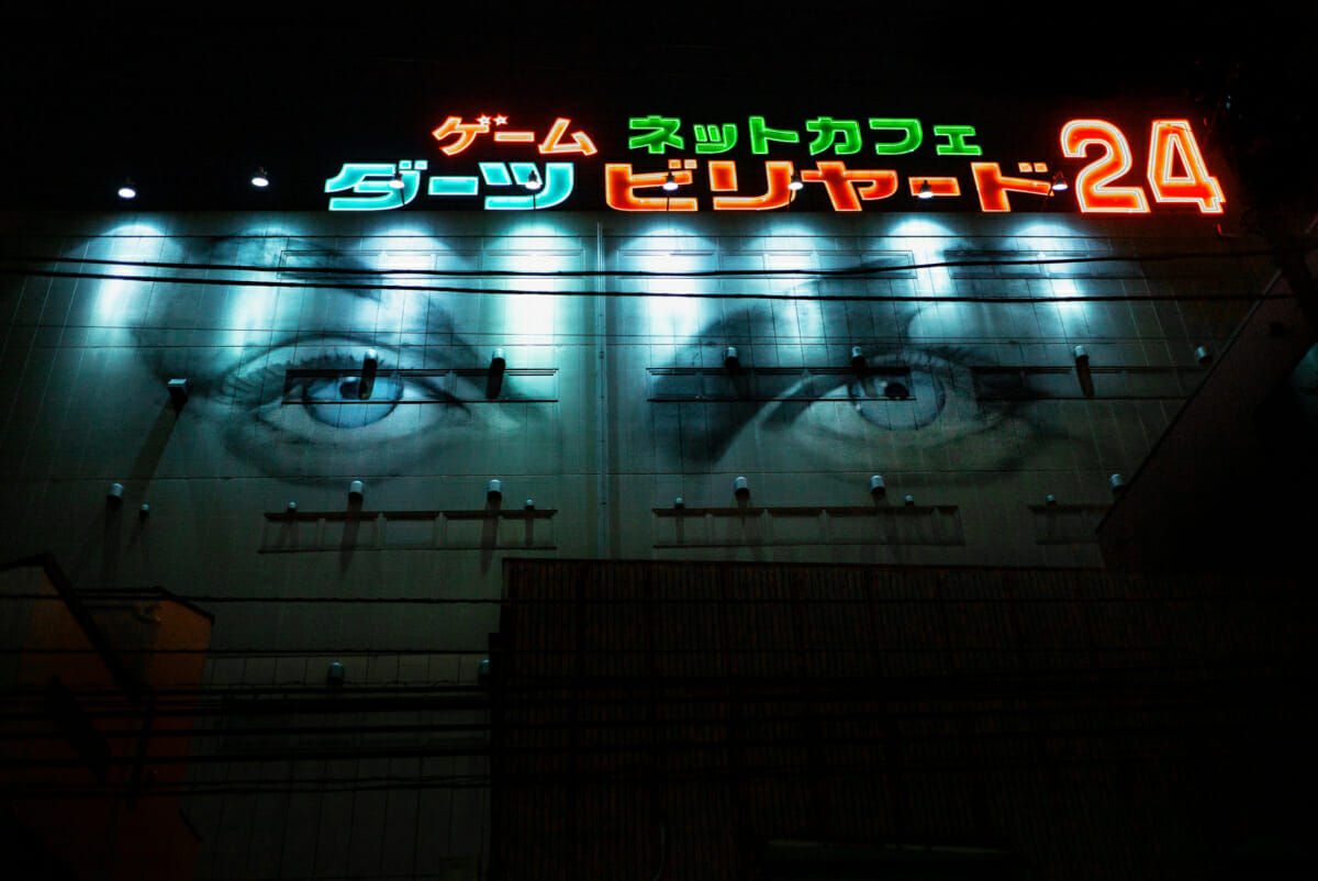 Japanese neon signs and walls with eyes