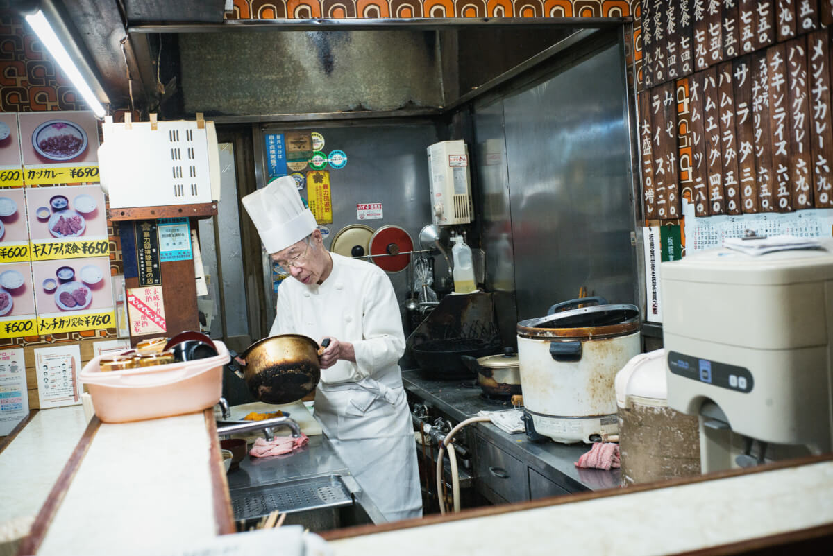 an old Japanese chef in an old Tokyo restaurant