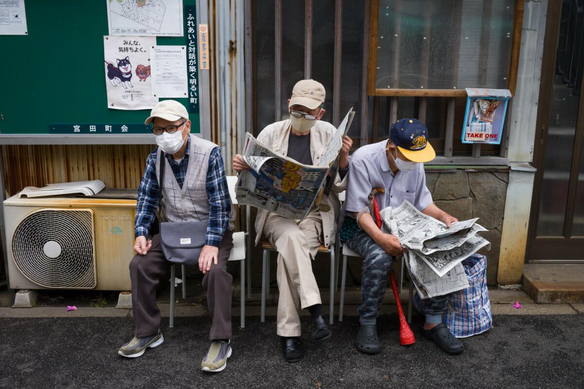 An old school Tokyo bus stop trio