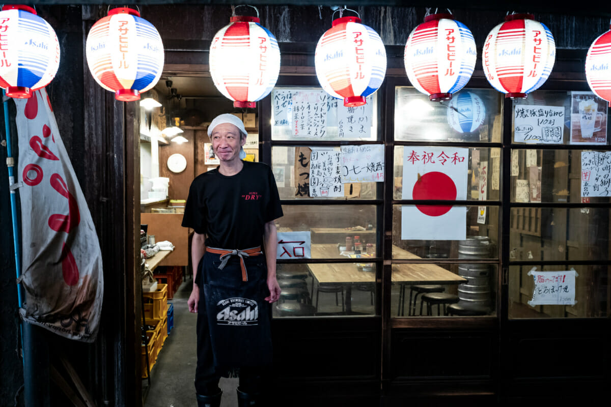 an old and retro tokyo bar and its owner