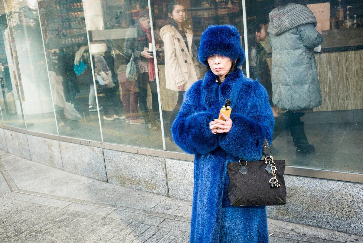 Striking Japanese woman in blue fur