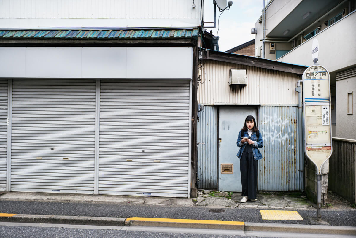 a gritty suburban tokyo bus stop