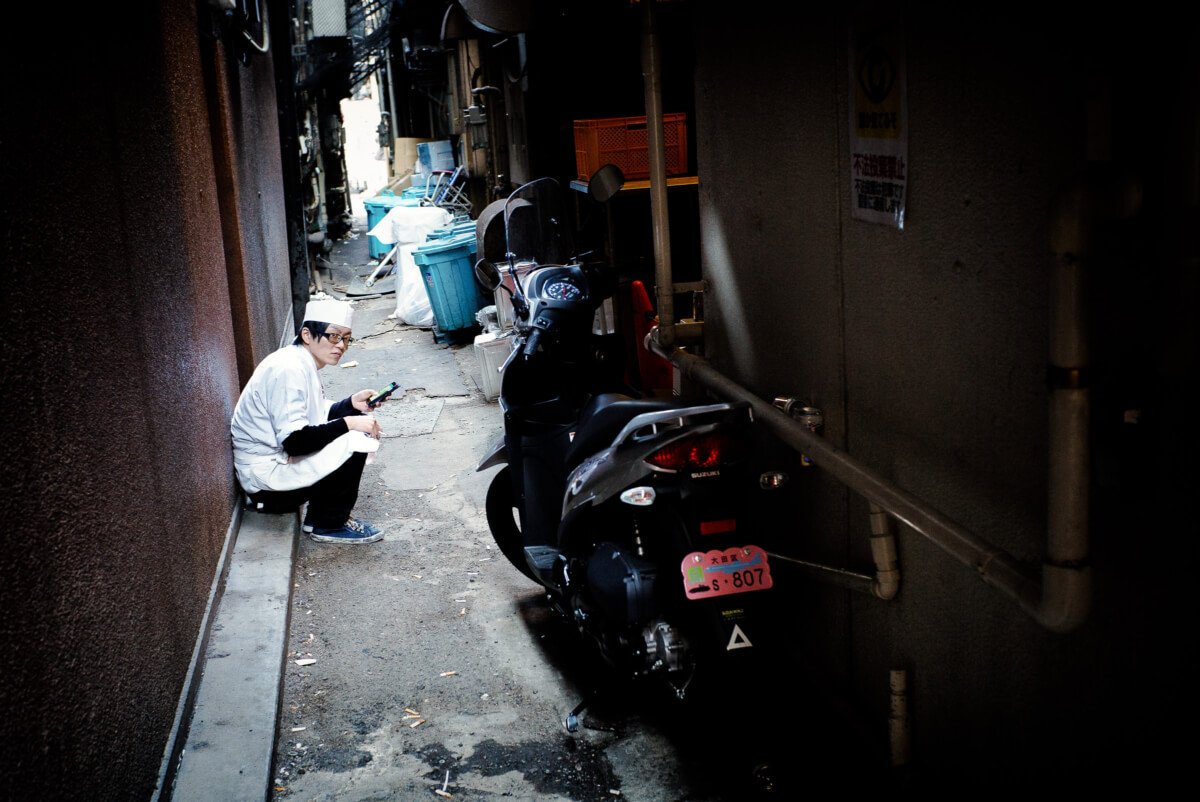 break time in a dirty tokyo alley