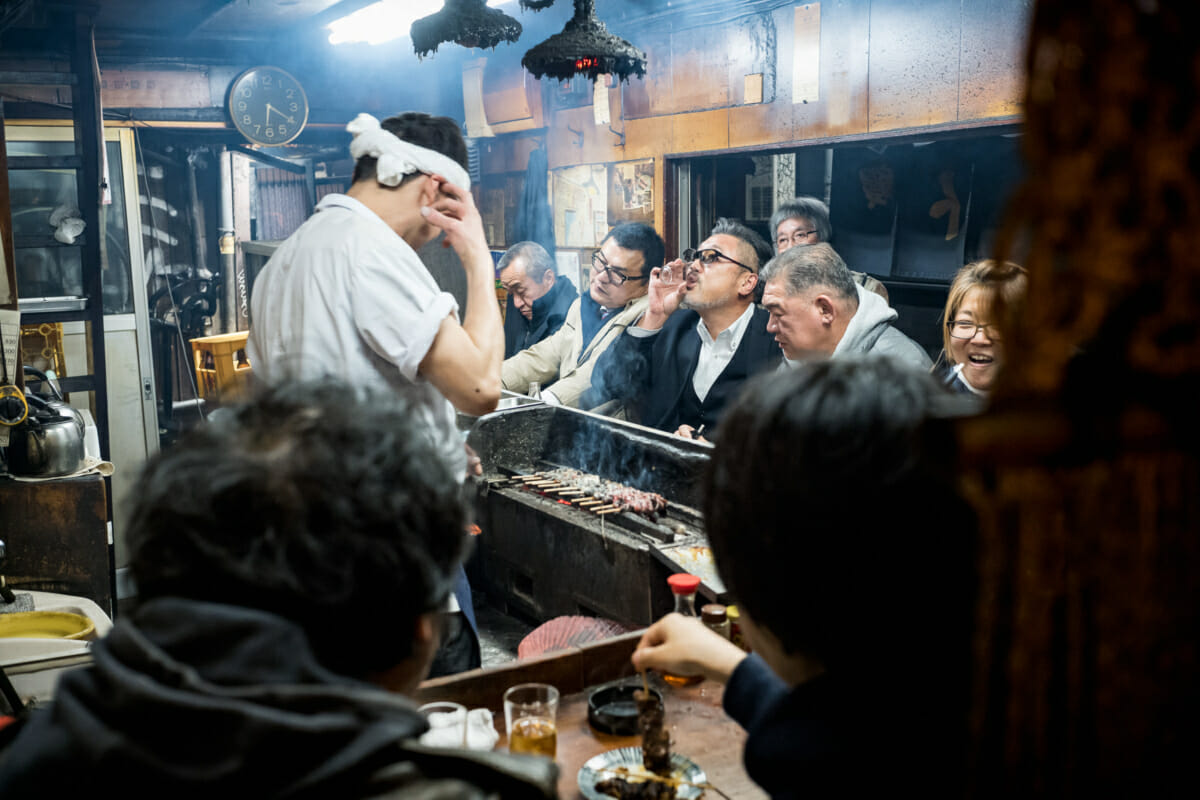 Japanese drinker in a dingy tokyo bar