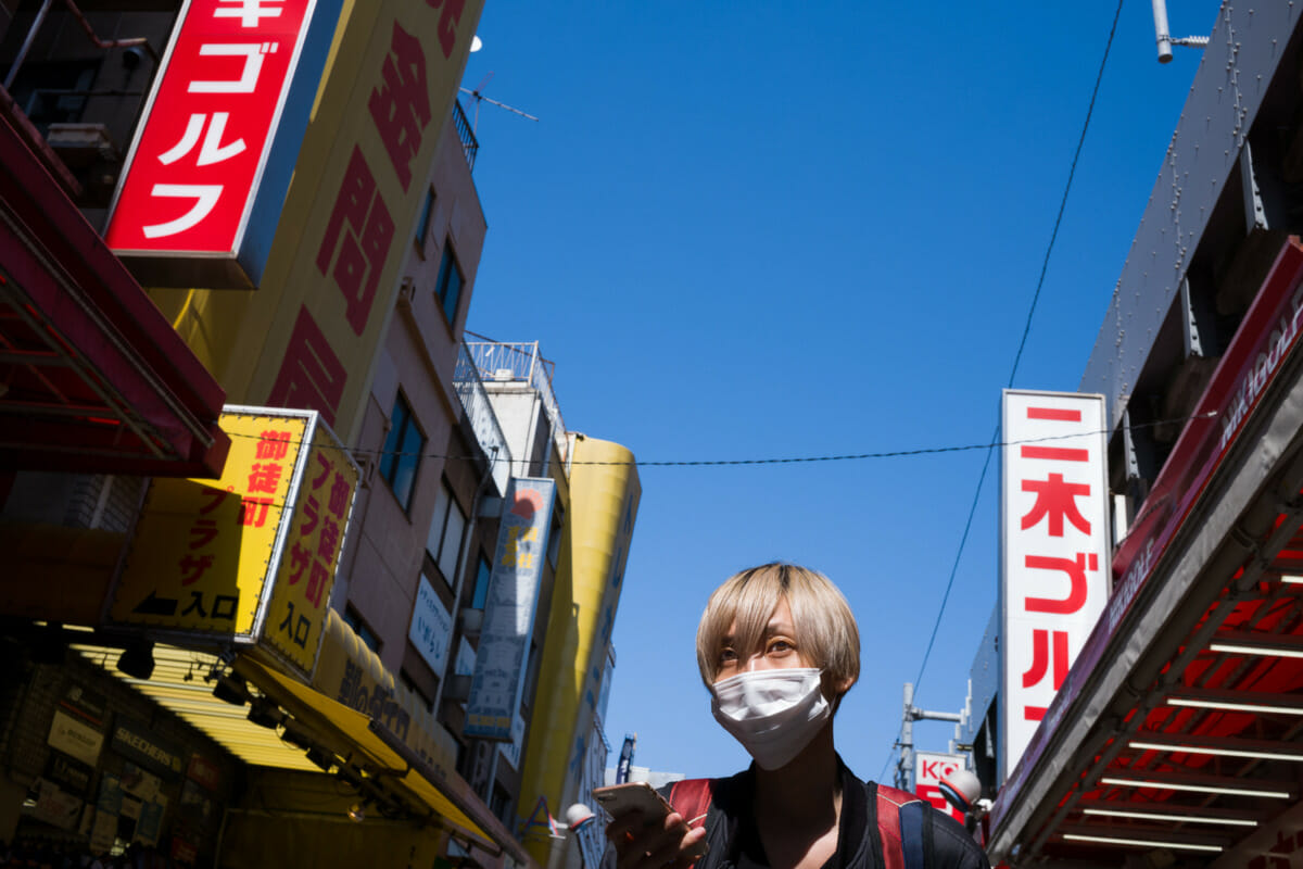 Tokyo eyes, sun and signage
