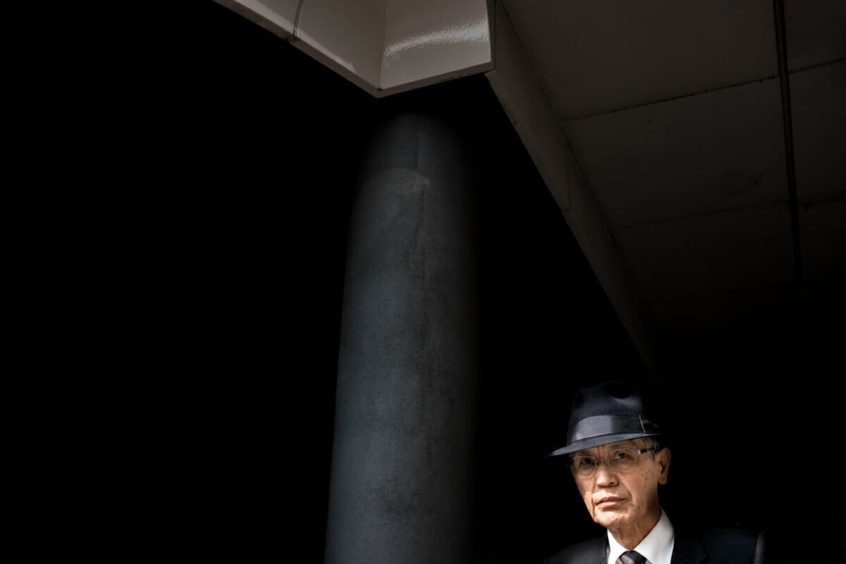 A Tokyo salary man emerging from the shadows