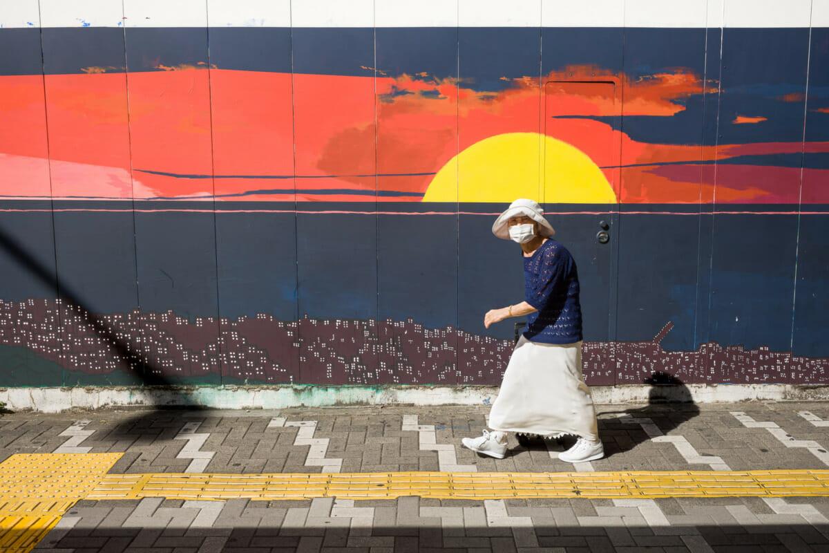 Tokyo setting sun urban art in the midday sun