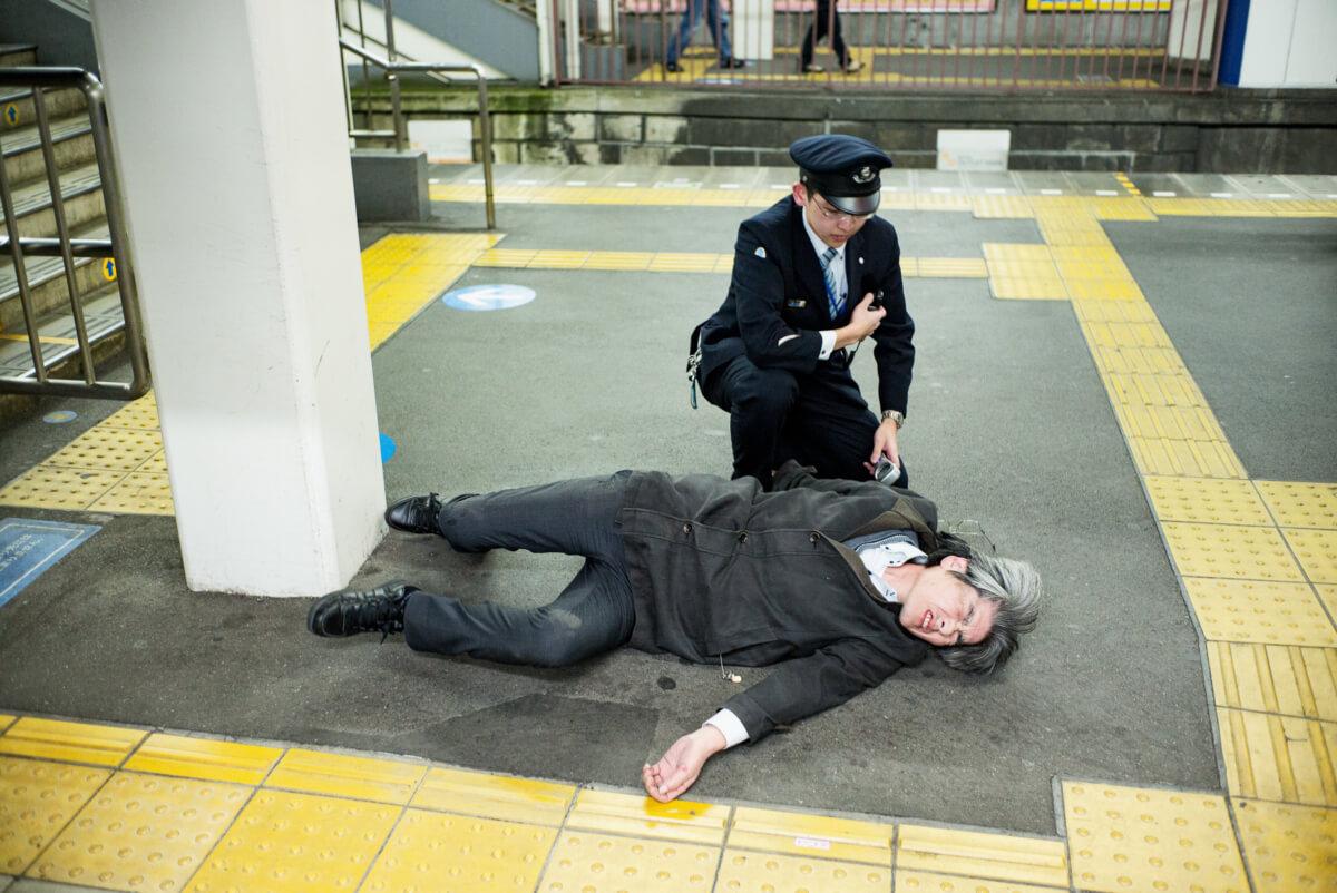 Japanese man drunk at a tokyo train station