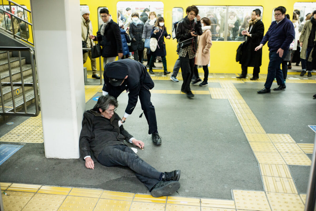 japanese man drunk at a tokyo train station