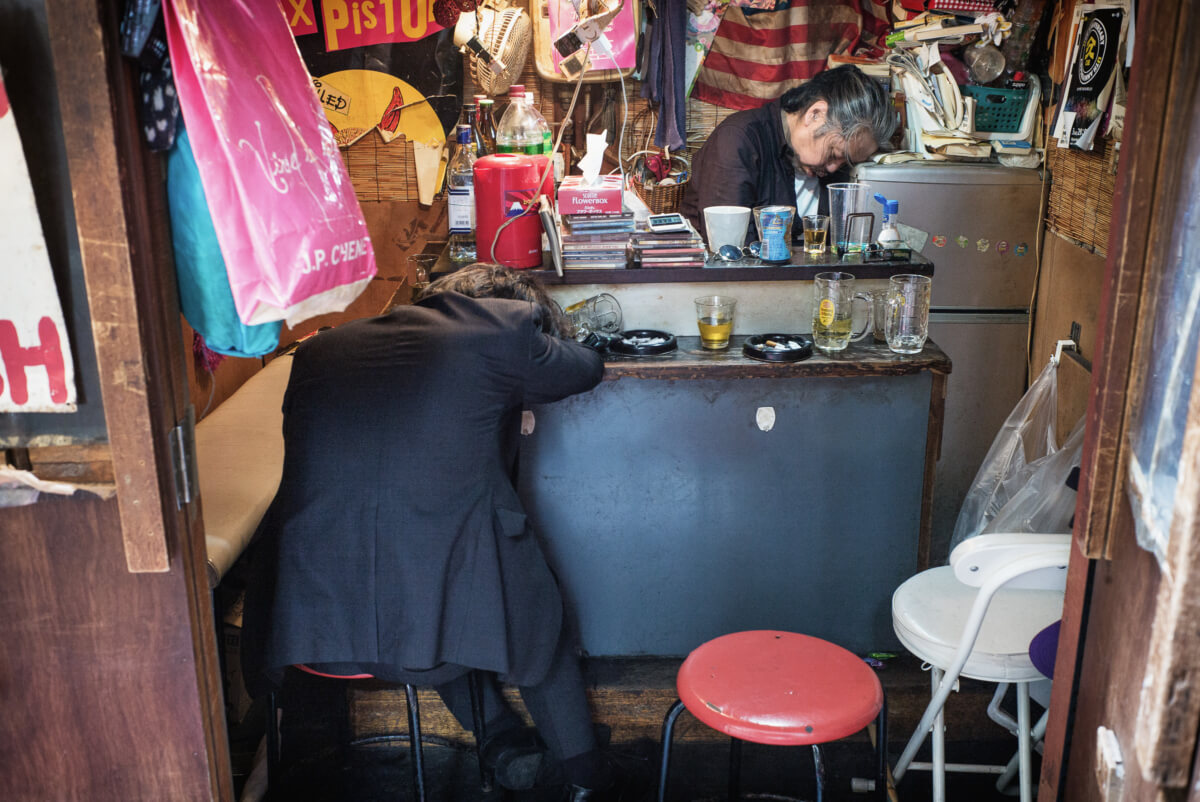 very drunk Japanese in a very small tokyo bar