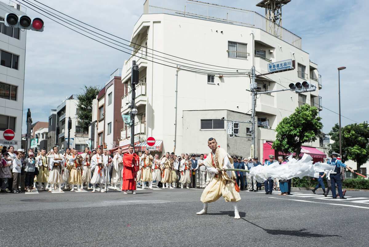 Shinto priests blessing a Tokyo crossing