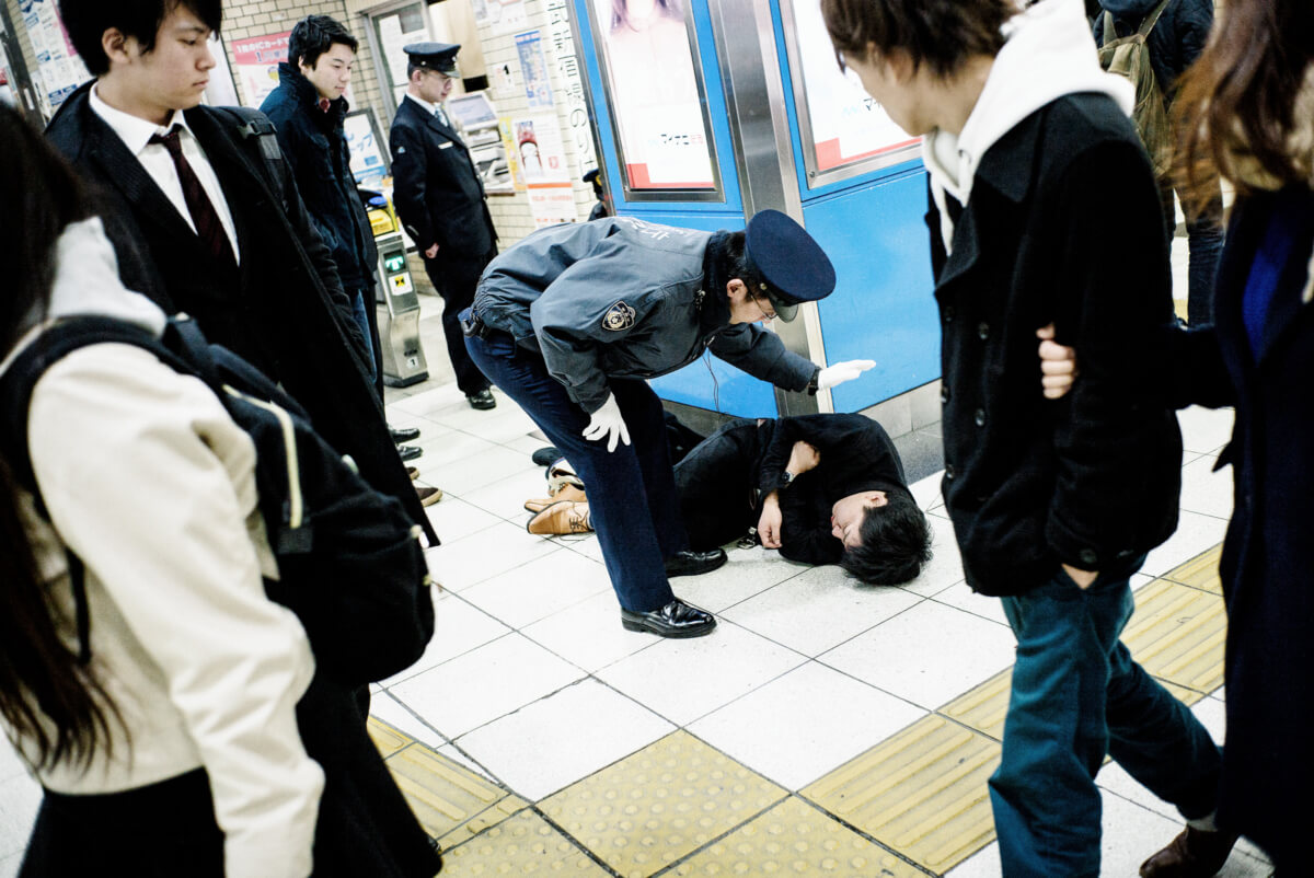 drunk man at a Tokyo train station