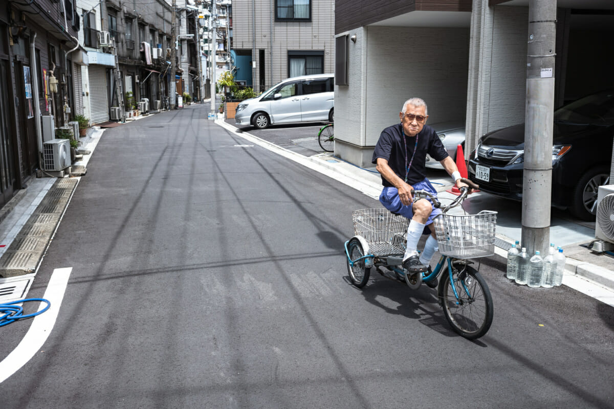 old Japanese man on a tricycle