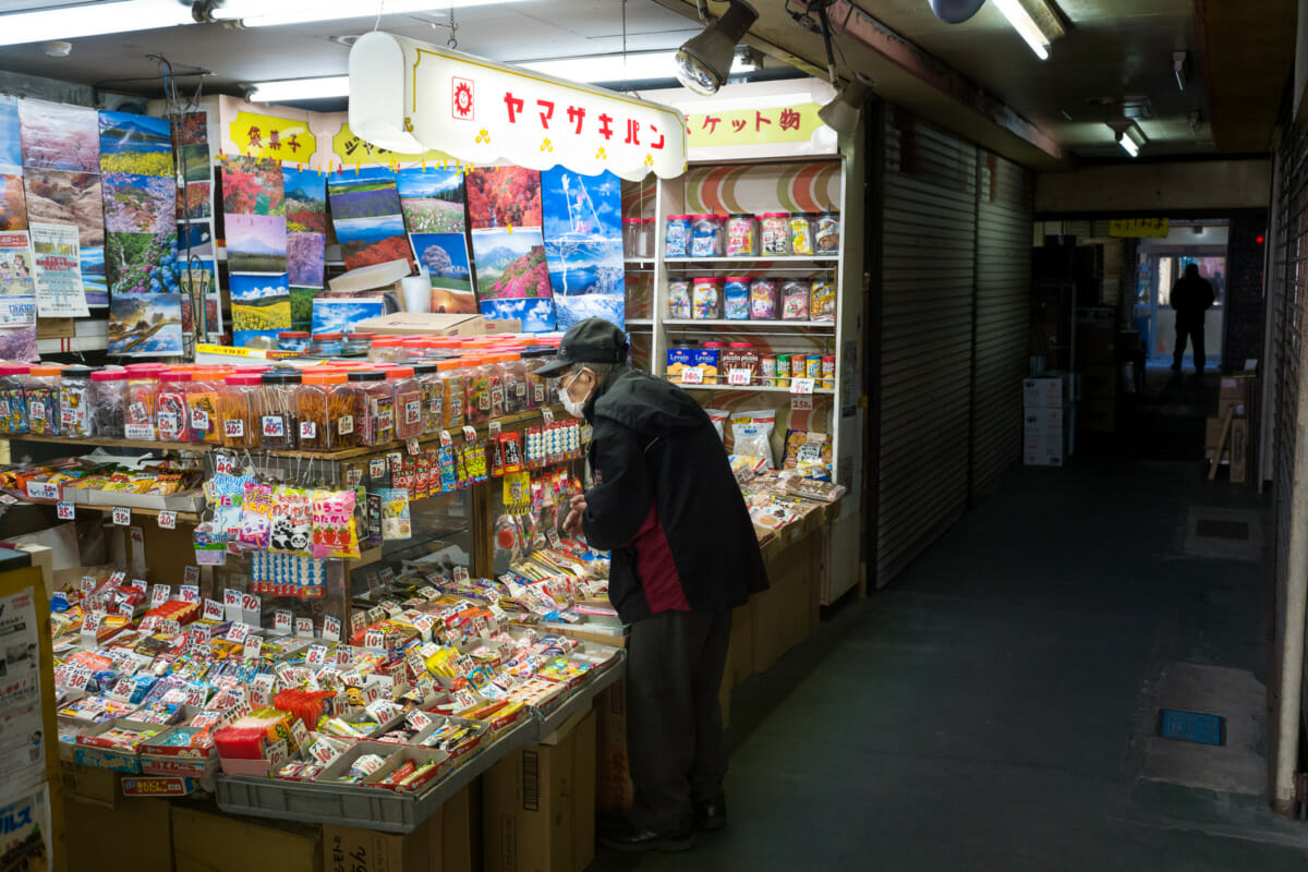 traditional little Japanese sweet shop in a dark Tokyo alleyway