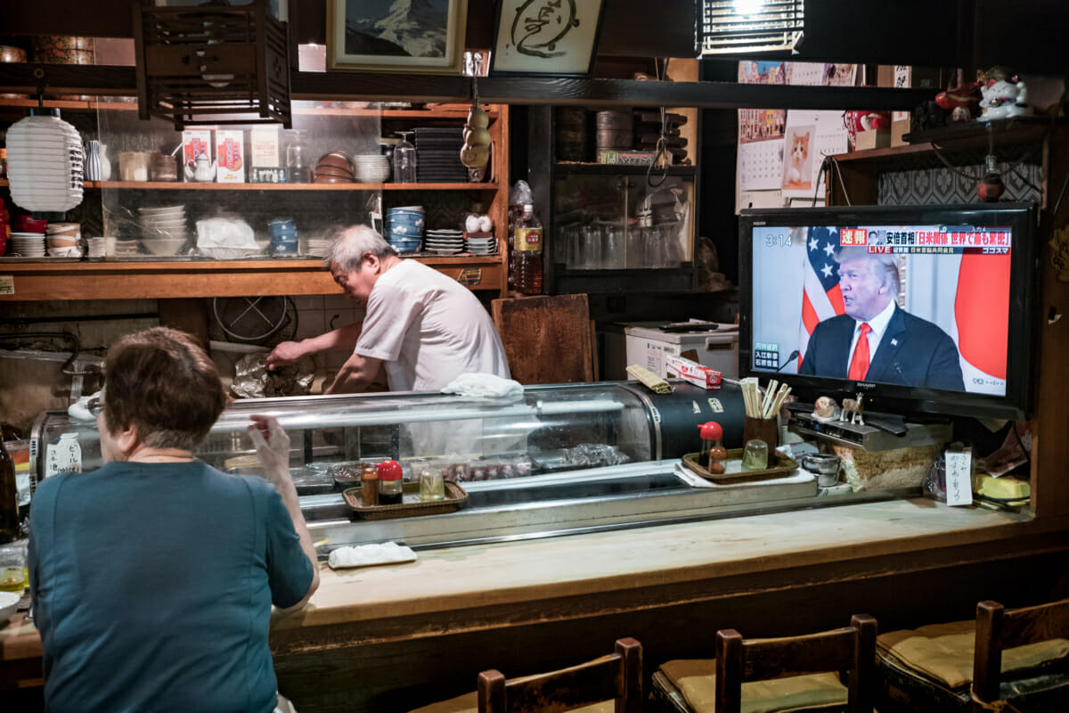 trump on tv in an old and traditional Tokyo bar